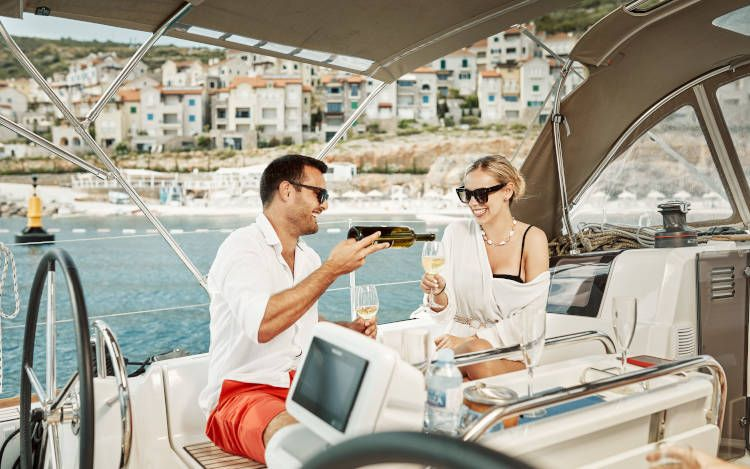 Couple drking wine onsailing boat Adriatic sea  at Lustica Bay Hotel Montenegro